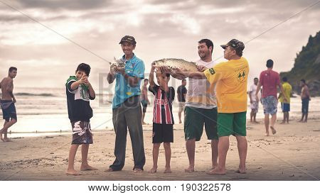 Ilha Do Mel Paraná Brazil - June 3 2017: Native fishermen from Ilha do Mel (Honey Island) holding fish for the photo.
