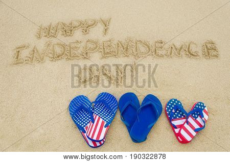 Independence USA background with flip flops on the sandy beach