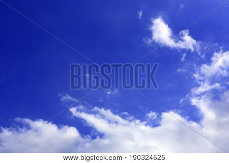 Abstract blue sky with white clouds
