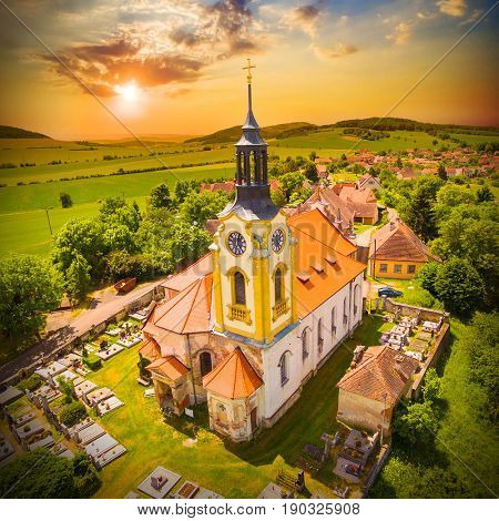 Church of St John the Baptist (1358) in small village Vreskovice. Architecture from above. Religious monument in Czech Republic, Central Europe.