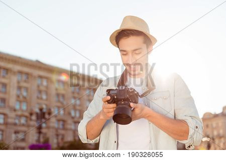 Nice Memories Of Summer Vacation! Young Male Tourist With A Digital Camera Is Checking The Photos He