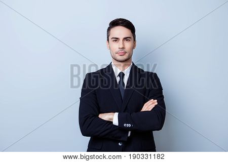 Successful Young Handsome Brunete Hispanic Man Lawyer In A Suit On Pure Background With Crossed Hand