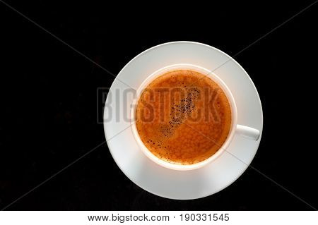 Freshly made tasty espresso cup of coffee on dark background