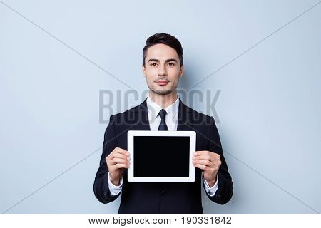 Handsome Young Brunete Economist Guy With Stubble Is Holding The Tablet With Black Screen. He Is Wea