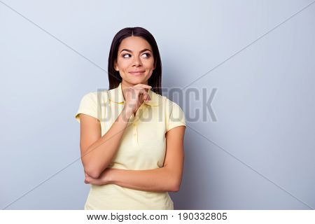 Portrait Of Playful Dreamy Young Latino American Brunete Lady, She Stands In Yellow Tshirt On Pure L