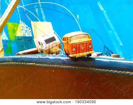 Nueva Esparta, Venezuela 5 september 2016. Volkswagen toy van on a suitcase, towing a caravan. Representing the scene of a fun trip.