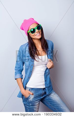 Portrait Of A Playful Young Funky Mulatto Girl In A Stylish Casual Clothes And Bright Green Sunglass