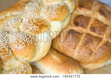 Various breads on a cutting board in a shop in Paris France. Shallow depth of field.