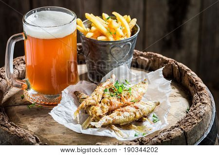 Smelt Fish And Chips With Cold Beer On Old Barrel