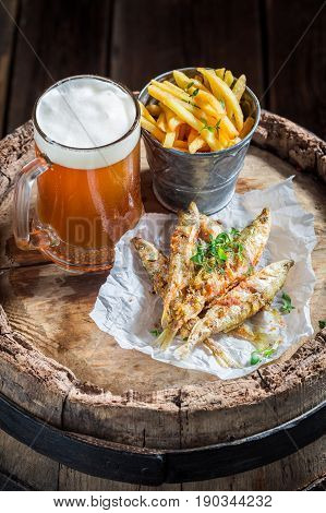 Smelt Fish With Cold Beer And Chips On Old Barrel