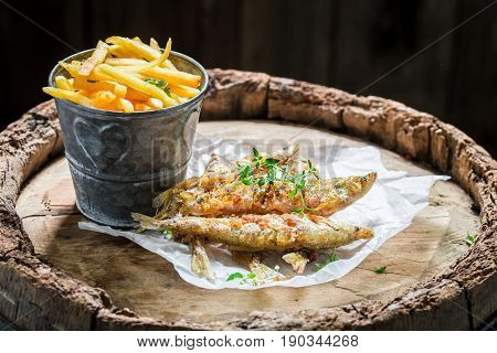 Roasted Smelt Fish With Herbs And Salt On Old Barrel