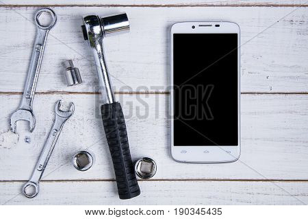 Smartphone And Equipment Repair On The White Wooden Background