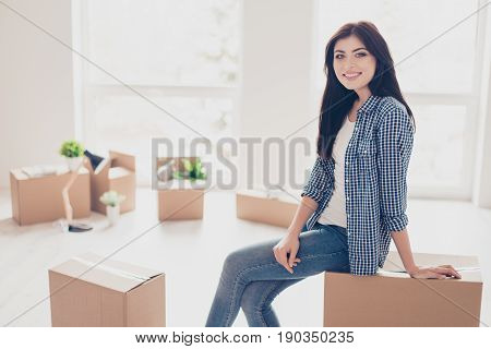 Home, Sweet Home! Young Cute Girl In Casual Clothes Is Sitting On The Box With Her Belongings In The
