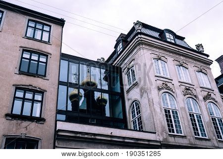 Copenhagen Denmark - August 10 2016. Low angle view of old building with cooper roof in historical city centre of Copenhagen. Copenhagen is the major economic and financial centre of Denmark.