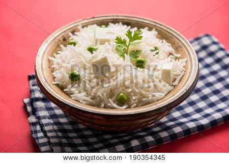 authentic paneer or soya bean or green peas pulav or vegetables rice or veg biryani with paneer cubes and soya chunk, selective focus