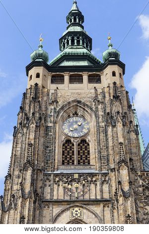 14th century St. Vitus Cathedral facade tower with clock Prague Czech Republic. It is a Roman Catholic metropolitan cathedral in Prague the seat of the Archbishop of Prague.