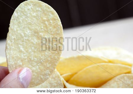 Potato chips in bowl on a table