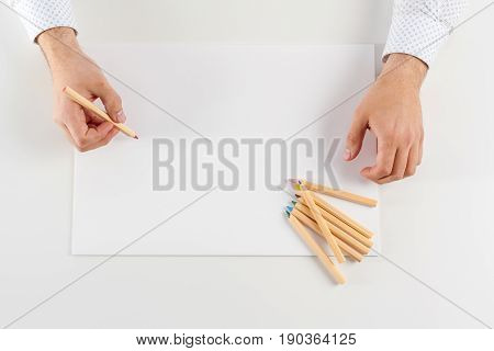 Man learning and writing on the table