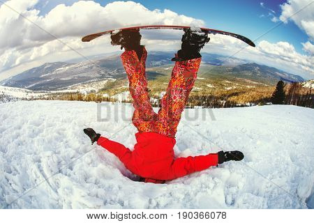 The snowboarder got stuck in the snowdrift. Cheerful production photo.