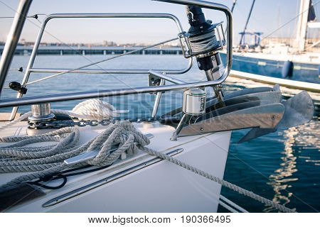 Yachting, sailing winch and ropes the front of the boat moored in the Harbor