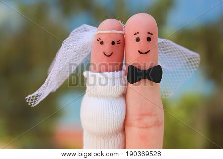Fingers art of a Happy couple. Concept of shotgun wedding, woman is pregnant and man needs to get married.