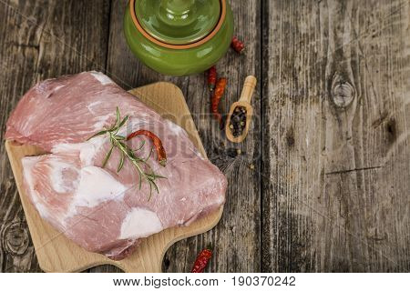 Raw Pork On A Wooden Cutting Board.