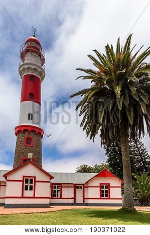 Red White Lighthouse, And Palm Tree, Swakopmund, German  Colonial Town, Namibia