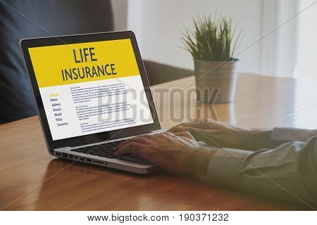 Life Insurance concept: Laptop computer with Life Insurance contract in the screen.