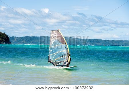 Windsurfing. Extreme sport active and healthy lifestyle concept. Bulabog beach Boracay Philippines