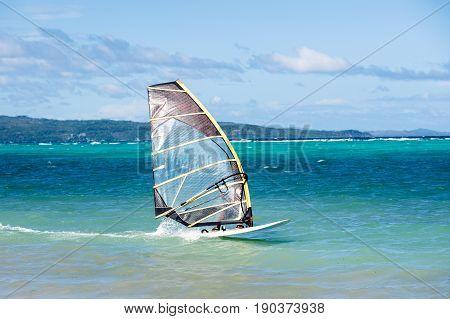 Windsurfing. Extreme sport active healthy lifestyle concept. Bulabog beach Boracay Philippines