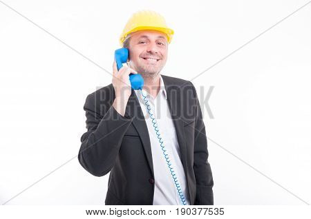 Portrait Of Architect Talking On Blue Big Telephone Receiver