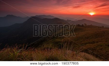 Sunset scene with the peak of mountain and cloudscape at Phu chi fa in Chiang raiThailand