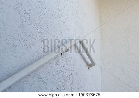 Metal Handrail On A Cement Wall