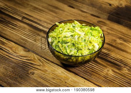 Savoy Cabbage Salad In Glass Bowl On Wooden Table