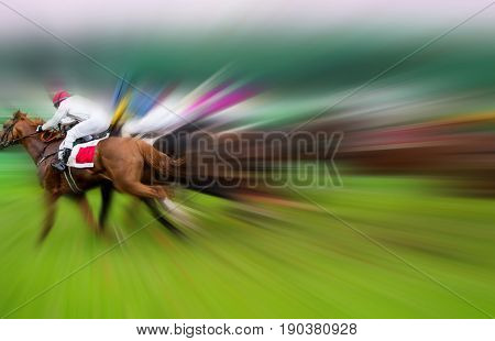 Race horses with jockeys on the home straight. Motion blurred.