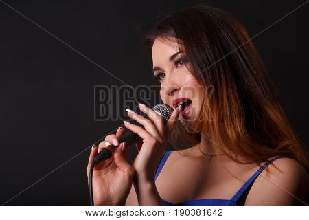 Portrait of woman with microphone