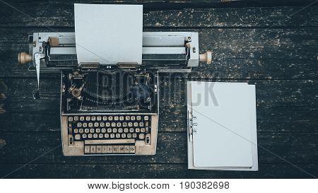 Vintage typewriter hero header on a wood background.