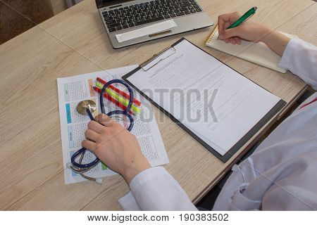 Shot of female medical doctor's hands. Healthcare and medical concept. Medicine doctor's working table