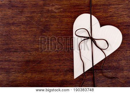 Bright Wooden Heart Tied With A Strap