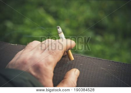 Cigarette in a man's hand. Close-up.