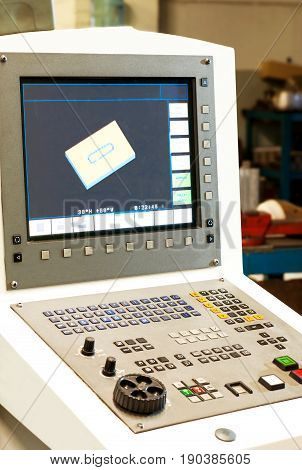 Computer numerical control machines bench-board and monitor with working program. Control panel of a programmable machine. Milling industry and lathe industry cnc technology and metal engineering.