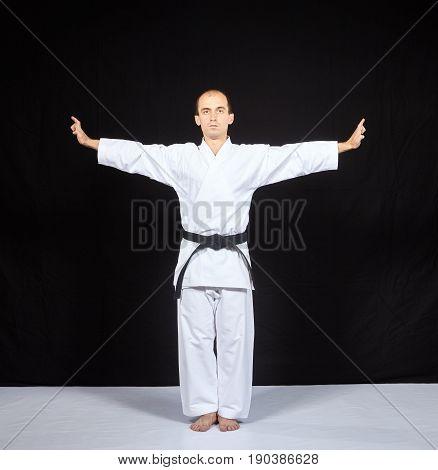 Blocks hands with a black belt athlete trains on a black background