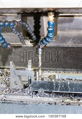 Industrial metal mold/blank speed drilling. Metalworking mechanical engineering lathe and milling technology. Indoors vertical image.