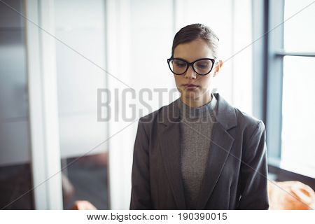 Thoughtful counselor in glasses at office