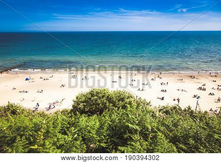 british seaside - summer holiday destination - top view of people on the beach in Bournemouth, Dorset, UK