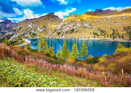 Mountain Lake Lago di Fedaia, Dolomites. Glacial lake with clear cold water. The concept of ecological and extreme tourism
