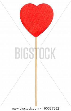 Red wooden heart on stick isolated on white background