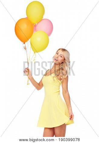 people, holidays and summer party concept - happy young woman or teen girl in pink dress with helium air balloons