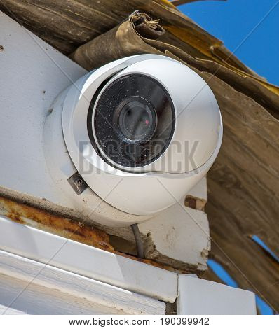 closeup on Security CCTV camera under blue sky