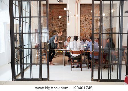 Young woman managing a team meeting in a boardroom